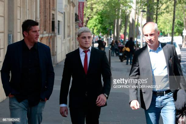 Australian international James O'Connor leaves after appearing before the French National Rugby League disciplinary commission in Paris on April 12...