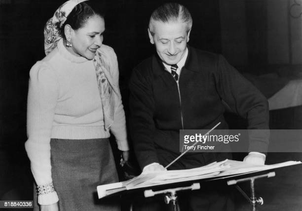 Australian jazz and blues singer Georgia Lee with bandleader Geraldo during a rehearsal at the BBC studios in Piccadilly London 29th January 1954...