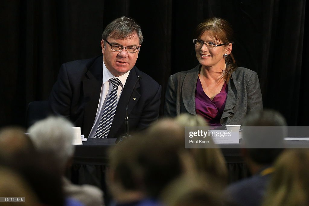 Australian Labour Cabinet Member Gary Gray answers a question from the public as Kate Lundy looks on at Thornlie Senior High School on March 27, 2013 in Perth, Australia. Gillard held a community cabinet meeting with members of her new front bench in the suburb of Thornlie today, in her first visit to WA since the Labor party lost state elections.