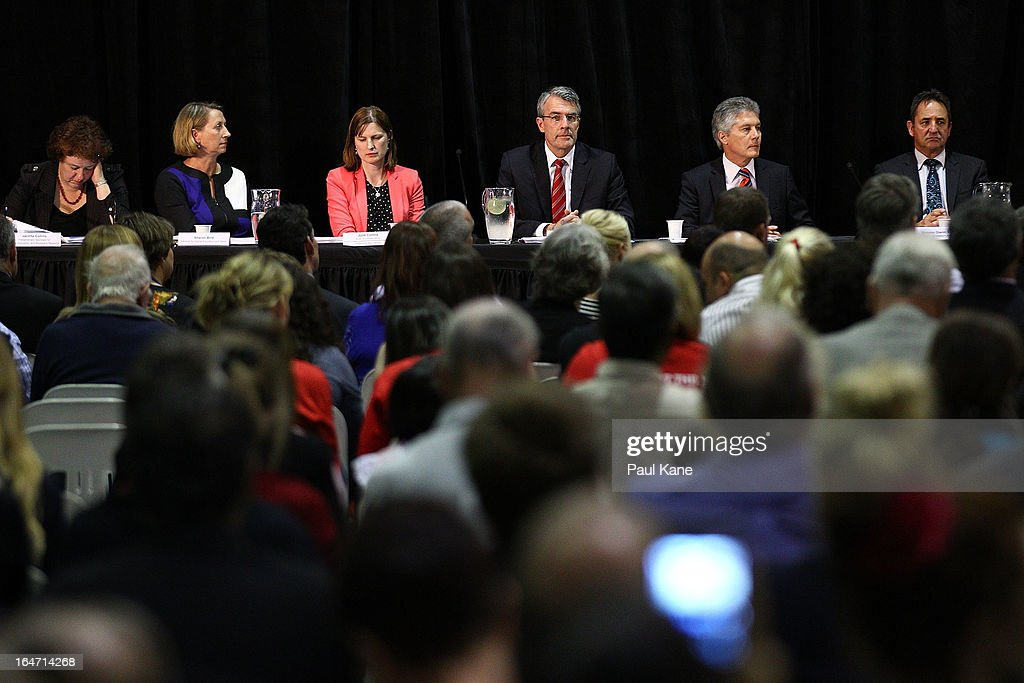 Australian Labour Cabinet Members Jacinta Collins, Sharon Bird, Judie Collins, Mark Dreyfus, Stephen Smith and Glenn Searle look on as Australian Prime Minister Julia Gillard addresses invited guests at Thornlie Senior High School on March 27, 2013 in Perth, Australia. Gillard held a community cabinet meeting with members of her new front bench in the suburb of Thornlie today, in her first visit to WA since the Labor party lost state elections.