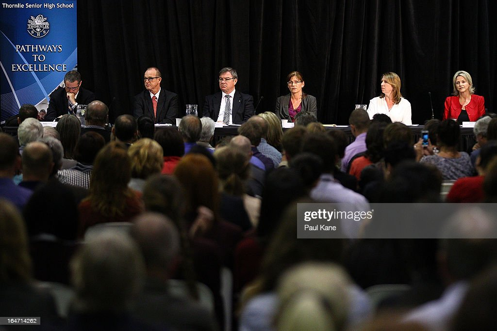 Australian Labour Cabinet Members Stephen Conroy, Joe Ludwig, Gary Gray, <a gi-track='captionPersonalityLinkClicked' href=/galleries/search?phrase=Kate+Lundy&family=editorial&specificpeople=4584077 ng-click='$event.stopPropagation()'>Kate Lundy</a>, Catherine King and Melissa Parke look on as Australian Prime Minister Julia Gillard addresses invited guests at Thornlie Senior High School on March 27, 2013 in Perth, Australia. Gillard held a community cabinet meeting with members of her new front bench in the suburb of Thornlie today, in her first visit to WA since the Labor party lost state elections.