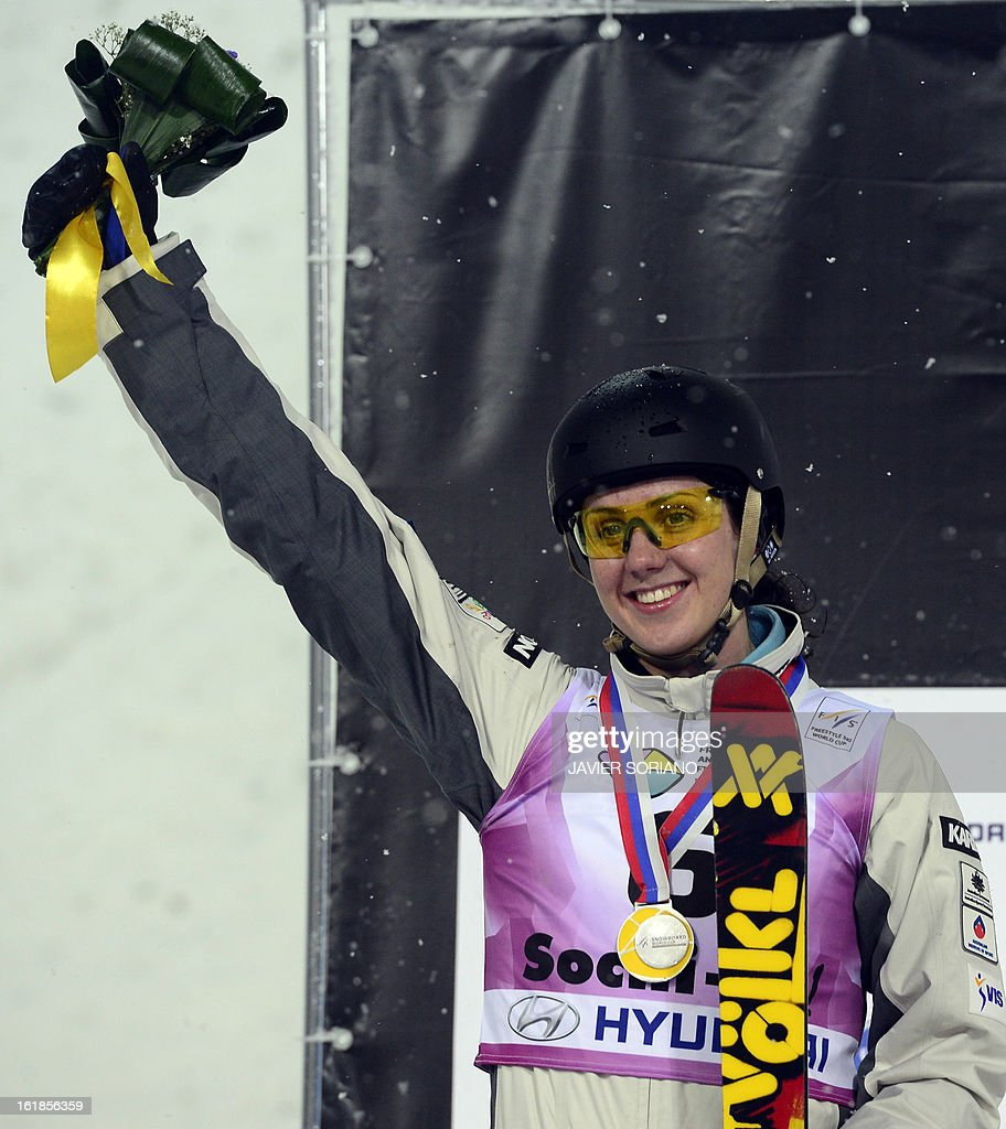Australian Laura Peel celebrates on podium after the Ladies' FreeStyle Aerials final race at the Snowboarding and Free Style World Cup Test Event at the Snowboard and Free Style Centre in Rosa Khutor near the Russian Black Sea resort of Sochi on February 17, 2013. Chinese Mengtao Xu won the race ahead of Australian Laura Peel and Swiss Tanja Schaerer.