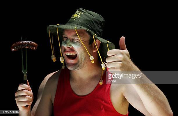 Hombre australiano en barbacoa