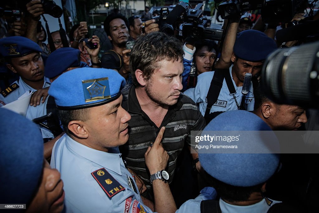 Australian Matt Christopher, (C), a passenger of Virgin Blue Australia Airplane, who is believed to have tried to enter the cockpit, is arrested by Indonesian millitary officers at International Ngurah Rai airport in Denpasar on April 25, 2014 in Denpasar, Bali, Indonesia. Early reports suggested an attempt to hijack a Virgin Australia had occured mid-flight, although Virgin has since clarified that the disturbance was caused by a drunk passenger acting aggressively and attempting to enter the cockpit.