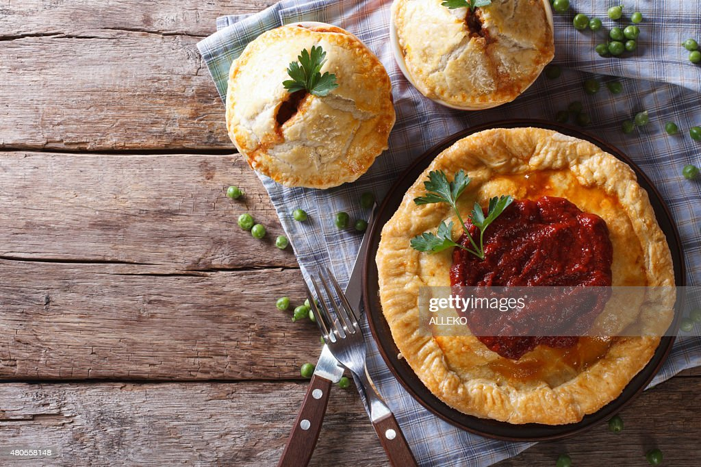 Australian meat pie on the table, horizontal view from above : Stock Photo