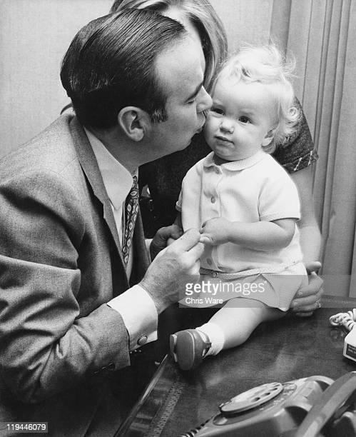 Australian media mogul Rupert Murdoch with his 14month old daughter Elisabeth at their home in Sussex Gardens London 4th October 1969 Behind them is...