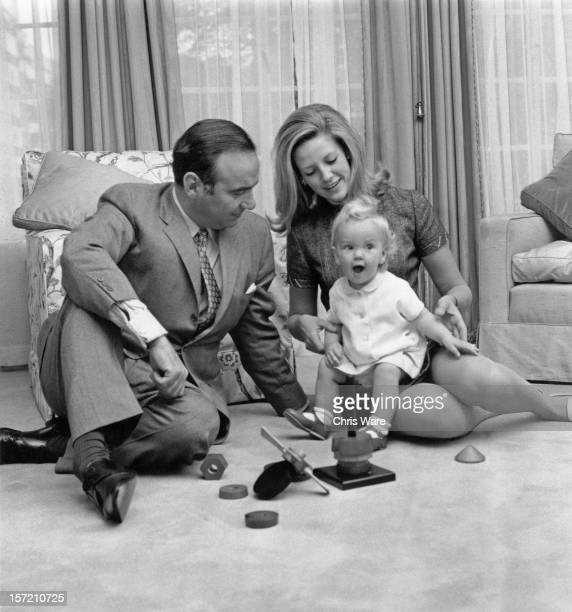 Australian media mogul Rupert Murdoch with his second wife Anna Maria Torv and their 14month old daughter Elisabeth at their home in Sussex Gardens...
