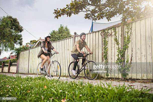 Australian mid adult couple riding bikes back home