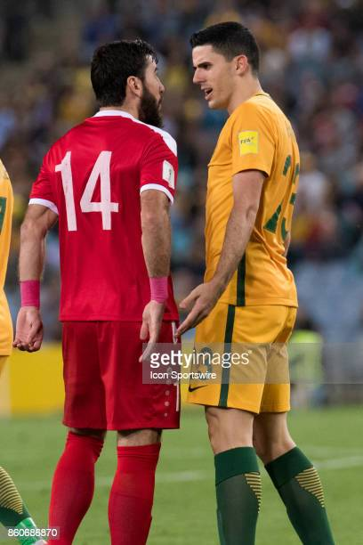 Australian midfielder Tomas Rogic and Syrian midfielder Tamer Haj Mohamd have a disagreement at the Soccer World Cup Qualifier between Australia and...