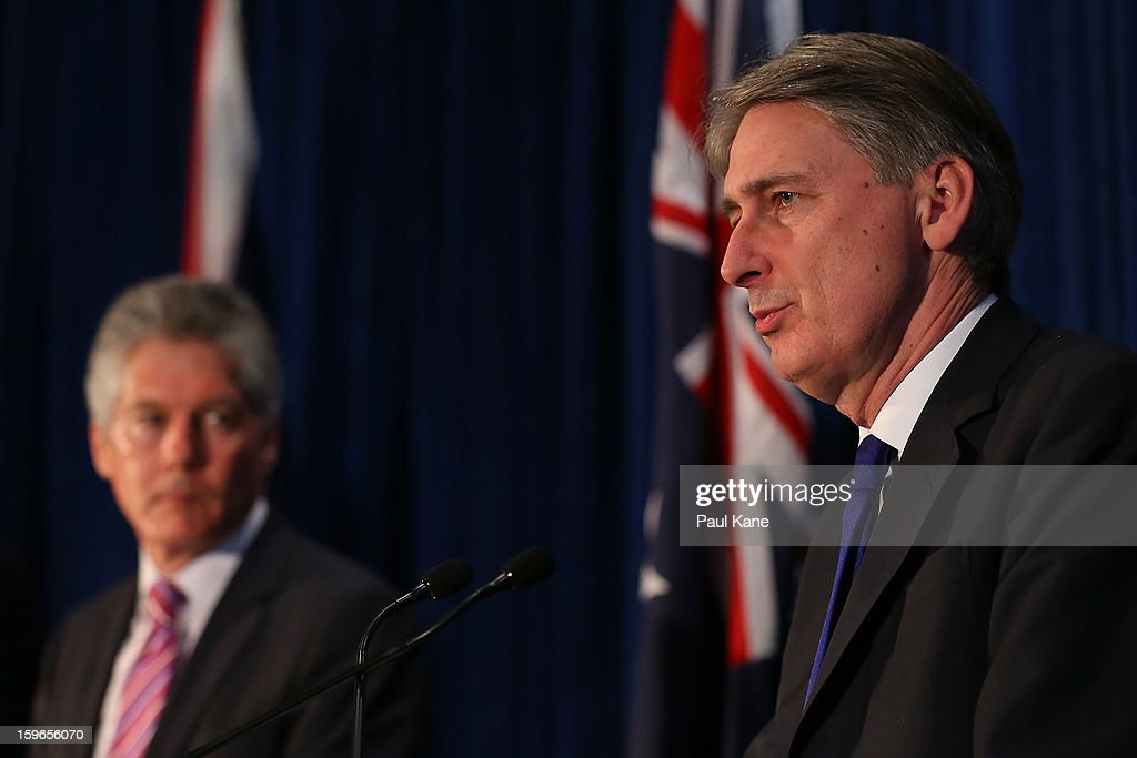 Australian minister for defence Stephen Smith looks on as British secretary of state for defence Philip Hammond addresses the media together with British secretary of state for foreign and commonwealth affairs William Hague, Australian foreign affairs minister Bob Carr during the annual Australia-United Kingdom Ministerial meetings on January 18, 2013 in Perth, Australia. The ministers meet to discuss defence and foreign affairs during the annual one-day summit.