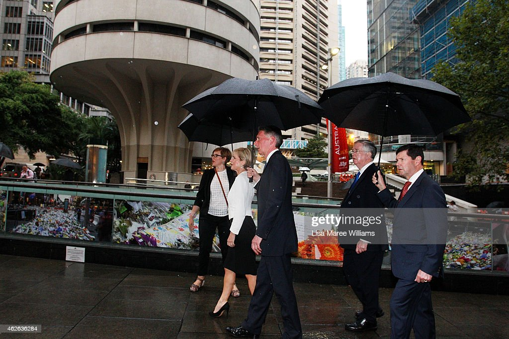 Australian Minister for Foreign Affairs, Julie Bishop, UK Secretary of State for Foreign and Commonwealth Affairs, Philip Hammond, UK Secretary of State for Defence, Michael Fallon and Australian Minister for Defence, Kevin Andrews look towards the Lindt Cafe Siege site at Martin Place on February 2, 2015 in Sydney, Australia. On December 15 2014, gunman Man Haron Monis was shot dead by police after taking hostages at the Lindt Chocolat Cafe in Martin Place. Two other people died, 33-year-old cafe manager Tori Johnson and 38-year-old Sydney barrister Katrina Dawson.