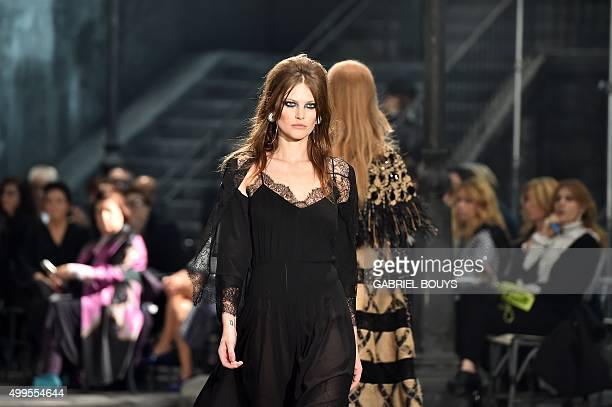 Australian Model Catherine McNeil presents a creation during the 12th Chanel Metiers dArt show 'ParisRome' an annual event to honor craftsmanship...