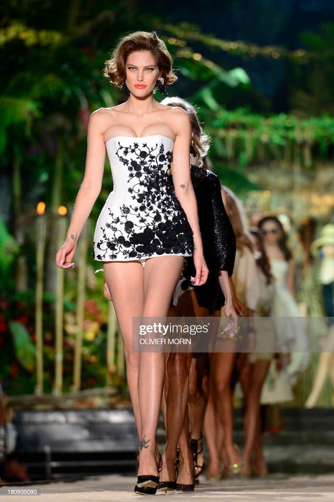 Australian model Catherine McNeil presents a creation for fashion house DSquared 2 as part of the spring/summer 2014 ready-to-wear collections during the fashion week in Milan on September 18, 2013.