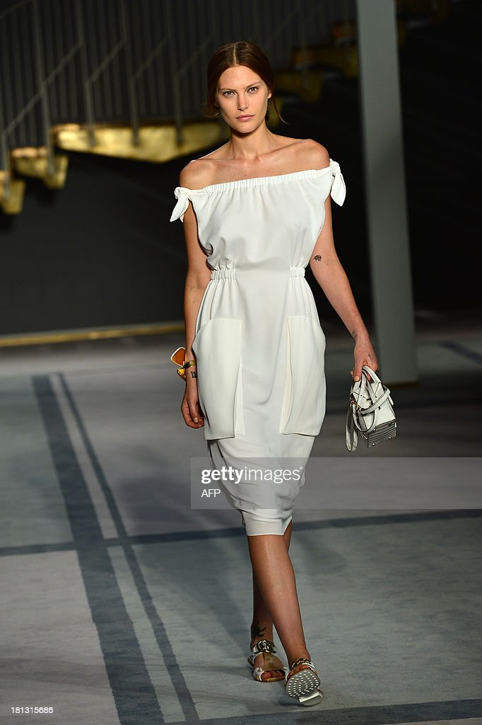 Australian model Catherine McNeil presents a creation for fashion house Tod's as part of the spring/summer 2014 ready-to-wear collections during the fashion week in Milan on September 20, 2013.