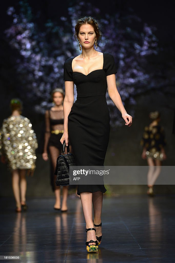 Australian model Catherine McNeil presents a creation for fashion house Dolce & Gabbana as part of the spring/summer 2014 ready-to-wear collections during the fashion week in Milan on September 22, 2013.
