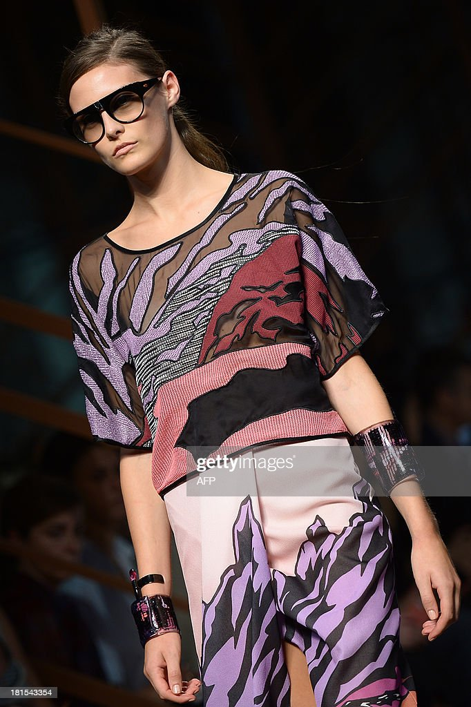 Australian model Catherine McNeil presents a creation for fashion house Missoni as part of the spring/summer 2014 ready-to-wear collections during the fashion week in Milan on September 22, 2013.