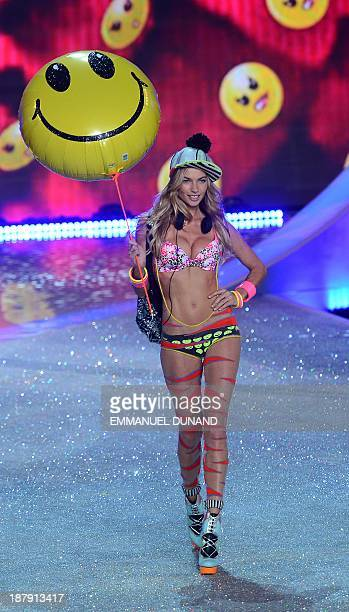 Australian model Jessica Hart performs during the 2013 Victoria's Secret Fashion Show at the Lexington Avenue Armory on November 13 2013 in New York...