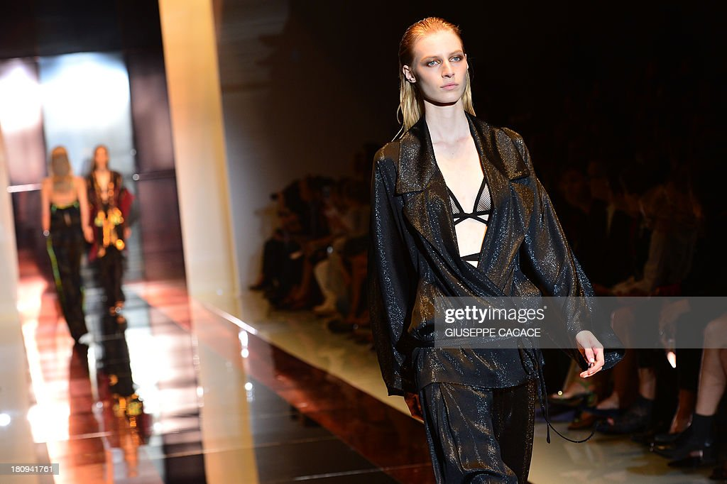 Australian model Julia Nobis presents a creation for fashion house Gucci as part of the spring/summer 2014 ready-to-wear collections during the fashion week in Milan on September 18, 2013.