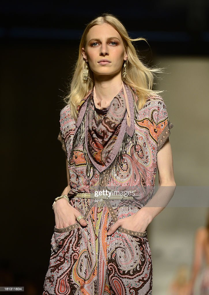 Australian model Julia Nobis presents a creation for fashion house Etro as part of the spring/summer 2014 ready-to-wear collections during the fashion week in Milan on September 20, 2013.