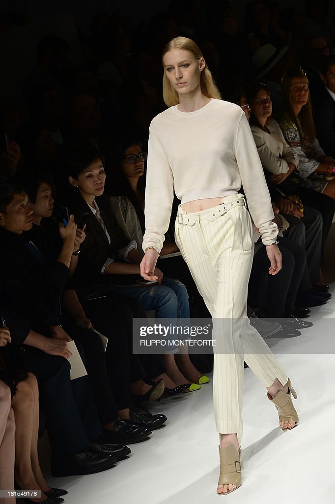Australian model Julia Nobis presents a creation for fashion house Salvatore Ferragamo as part of the spring/summer 2014 ready-to-wear collections during the fashion week in Milan on September 22, 2013.
