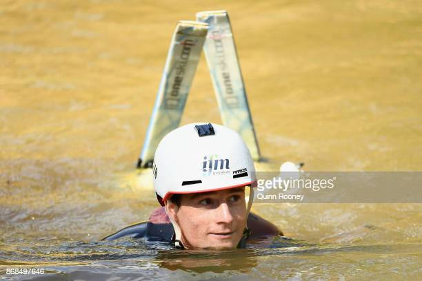 Australian mogul skier Matt Graham comes out of the water after going off the water jump during an Australian Ski Jump training session on October 31...