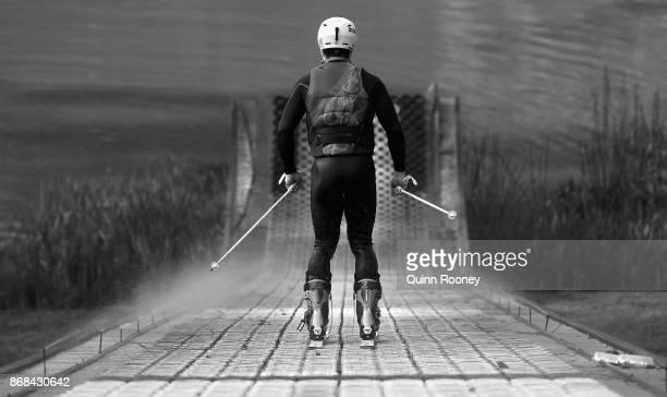 Australian mogul skier Matt Graham goes down the water jump during an Australian Ski Jump training session on October 31 2017 in Melbourne Australia