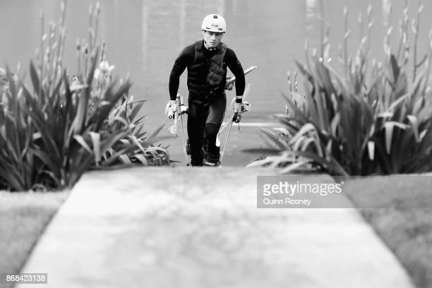 Australian mogul skier Matt Graham walks back up to the top of the water jump during an Australian Ski Jump training session on October 31 2017 in...