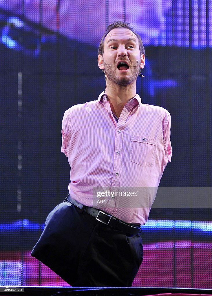 Australian motivational speaker Nick Vujicic delivers a speech to 50,000 spectators at the Taipei World Trade Center Nangang Exhibition Hall on December 14, 2013. Vujicic is on a three-day visit to Taiwan financed by a local private business and the Red Heart Association to deliver two speeches for a total of 100,000 people from December 14. AFP PHOTO / Mandy CHENG