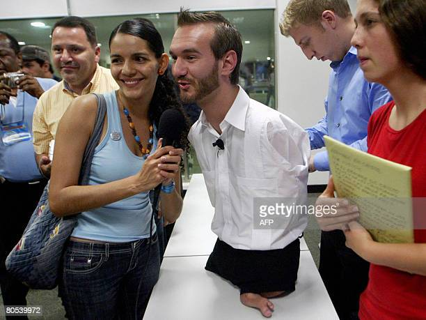 Australian motivational speaker Nick Vujicic who was born limbless poses before the start of a conference on April 5 in Cali department of Valle del...