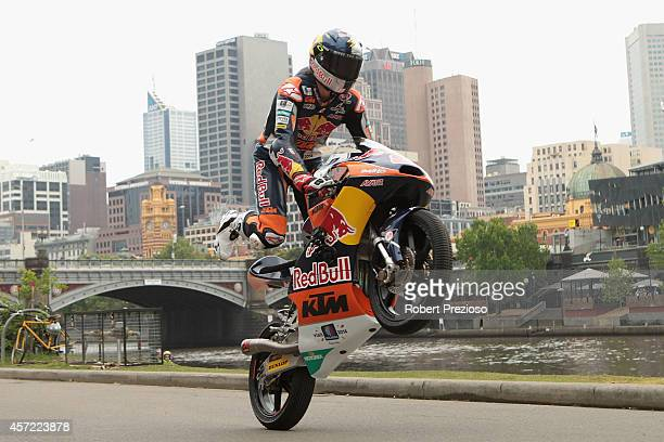 Australian Moto 3 rider Jack Miller performs during a bike run on Yarra River on October 15 2014 in Melbourne Australia