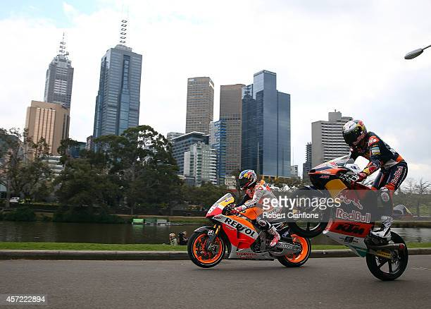 Australian Moto3 rider Jack Miller and Spanish MotoGp rider Dani Pedrosa ride their motorbikes during a bike run on Yarra River on October 15 2014 in...