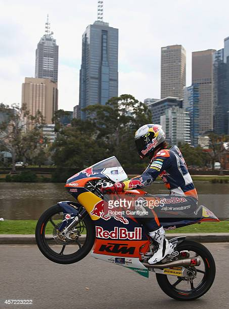 Australian Moto3 rider Jack Miller rides his motorbike during a MotoGp bike run on Yarra River on October 15 2014 in Melbourne Australia