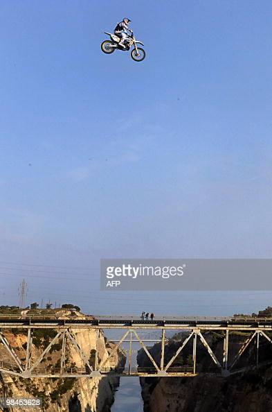 Australian motocrosser Robbie Maddison performs a jump over the 85metre wide Corinth Canal in the city of Corinth some 80 km southwest of Athens on...