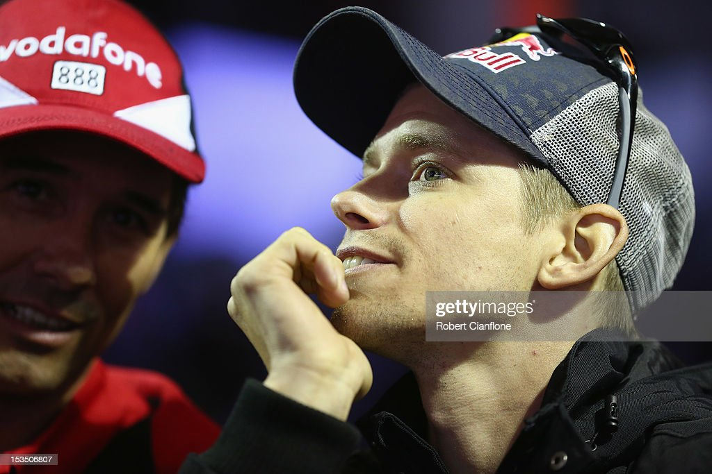 Australian MotoGp rider <a gi-track='captionPersonalityLinkClicked' href=/galleries/search?phrase=Casey+Stoner&family=editorial&specificpeople=563465 ng-click='$event.stopPropagation()'>Casey Stoner</a> looks on in the Vodafone pit garage during the Top 10 shootout for the Bathurst 1000, which is round 11 of the V8 Supercars Championship Series at Mount Panorama on October 6, 2012 in Bathurst, Australia.