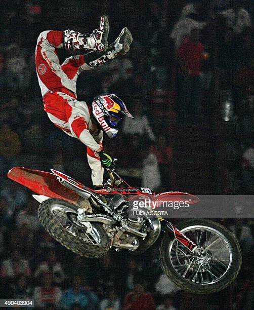 Australian motorcyclist Robbie Maddison performs during the freestyle motocross show first round of the World tour 'Red Bull X Fighters' at the Bull...