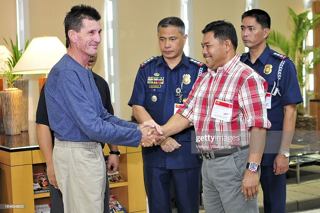 Australian national Warren Rodwell is greeted by Philippine National Police officials and Basilan Vice-Governor Al Rashid Sakalahul before he delivers a short statement to the media at Manila International Airport on March 25, 2013 in Manila, Philippines. Rodwell was reportedly released on March 23 after allegedly paying $90,000 USD to secure his safety after being held as a hostage of Islamic militants in the southern Philippines for 15 months.