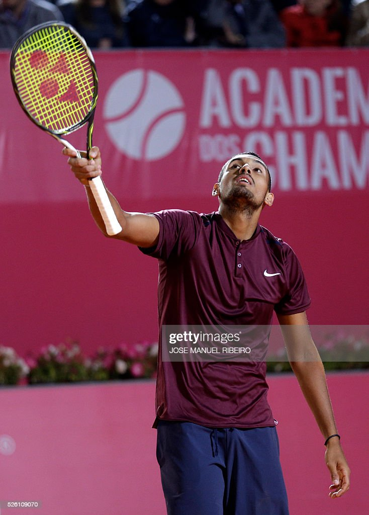 Australian Nick Kyrgios celebrates a point against Croatian Borna Coric during their quarter-final Estoril Open Tennis tournament in Estoril on April 29, 2016. / AFP / JOSE