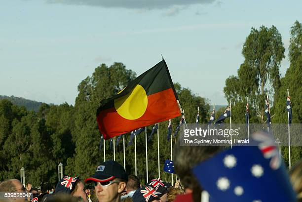 Australian of the year awards held at the front of parliament house on 25 January 2005 shows Aboriginal flag amonst Australian flags SMH NEWS Picture...
