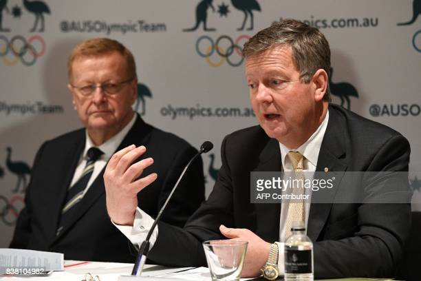 Australian Olympic Committee chief executive officer Matt Carroll speaks beside AOC president John Coates during a press conference in Sydney on...