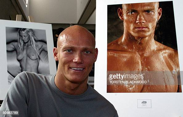Australian Olympic doublegold medalist swimmer Michael Klim displays one of his portraits by Paul Freeman at the launch of BlackWhite magazine's...