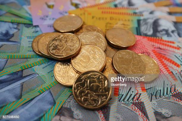 Australian one dollar coins and banknotes of various denominations are arranged for a photograph in Sydney Australia on Friday Aug 4 2017 The...