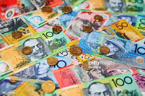 Australian onedollar coins and banknotes of various denominations are arranged for a photograph in Sydney Australia on Thursday July 24 2015 The...