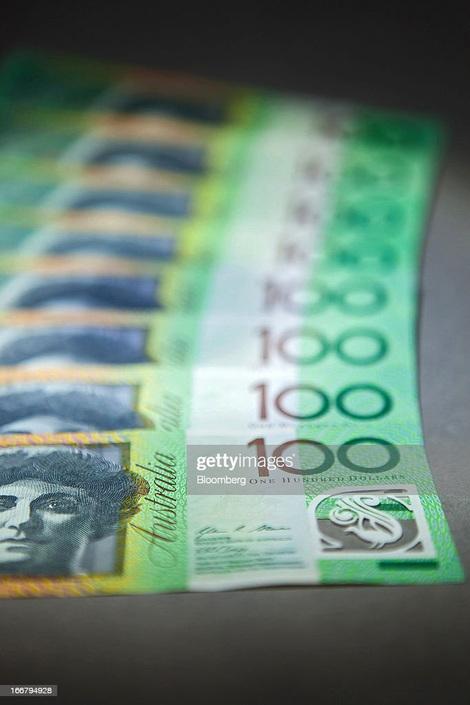 Australian one-hundred dollar banknotes are arranged for a photograph in Sydney, Australia, on Wednesday, April 17, 2013. Direct trading between the Australian dollar and yuan started on April 10. Photographer: Ian Waldie/Bloomberg via Getty Images