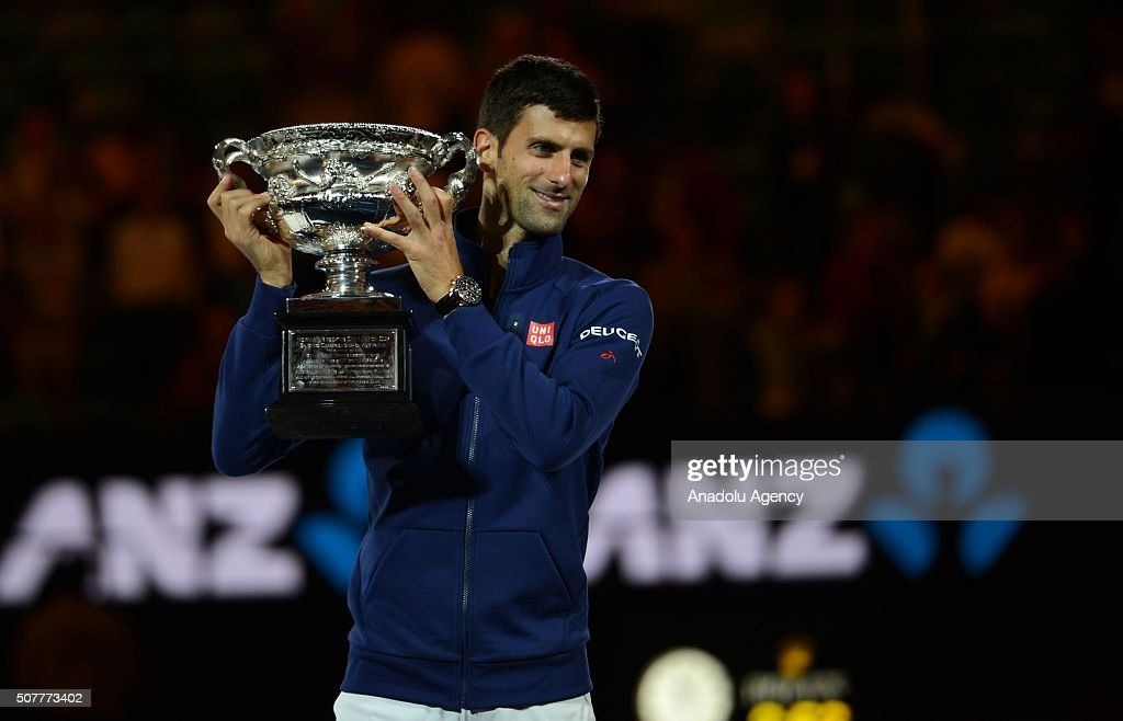 Australian Open 2016 champion Novak Djokovic of Serbia raises the Norman Brookes Challenge Cup after the Men's Singles Final during day 14 of the 2016 Australian Open at Melbourne Park on January 31, 2016 in Melbourne, Australia.