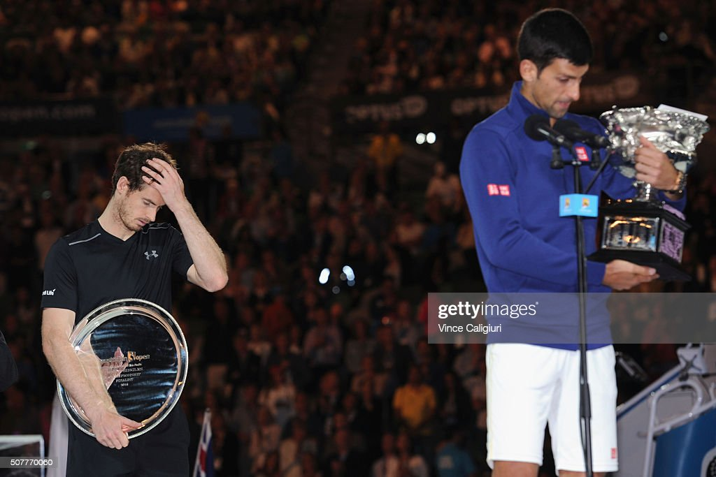 Australian Open champion <a gi-track='captionPersonalityLinkClicked' href=/galleries/search?phrase=Novak+Djokovic&family=editorial&specificpeople=588315 ng-click='$event.stopPropagation()'>Novak Djokovic</a> of Serbia holds the Norman Brookes Challenge Cup as <a gi-track='captionPersonalityLinkClicked' href=/galleries/search?phrase=Andy+Murray+-+Tennis+Player&family=editorial&specificpeople=200668 ng-click='$event.stopPropagation()'>Andy Murray</a> of Great Britain looks on after the Men's Singles Final during day 14 of the 2016 Australian Open at Melbourne Park on January 31, 2016 in Melbourne, Australia.