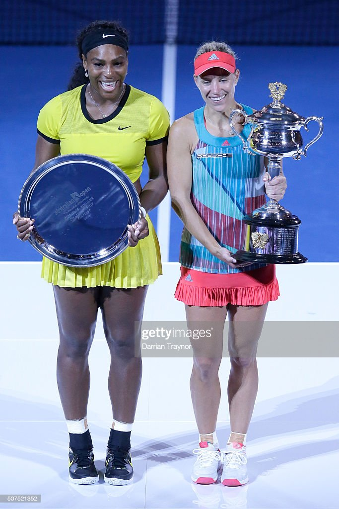 Australian Open runnerup Serena Williams of the United States and winner Angelique Kerber of Germany pose with their trophies after Women's Singles...