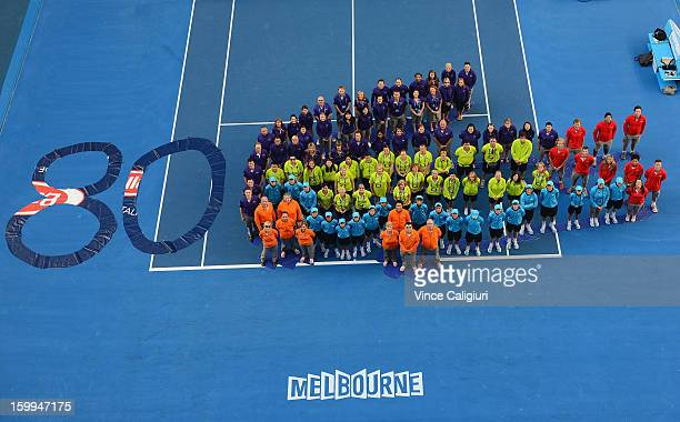 Australian Open staff pose in the shape of the Lacoste logo to celebrate their 80th Anniversary on day eleven of the 2013 Australian Open at...