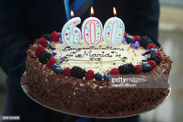 Australian Open Tournament Director Craig Tiley presents a cake to Maria Sharapova of Russia to commemorate her 600th career singles win during day...
