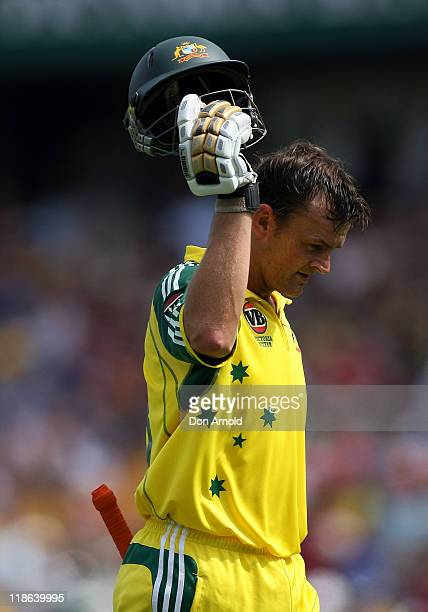 Australian opening batsman Adam Gilchrist walks off the field to a standing ovation after his whirlwind innings of 88 runs which came of just 69...