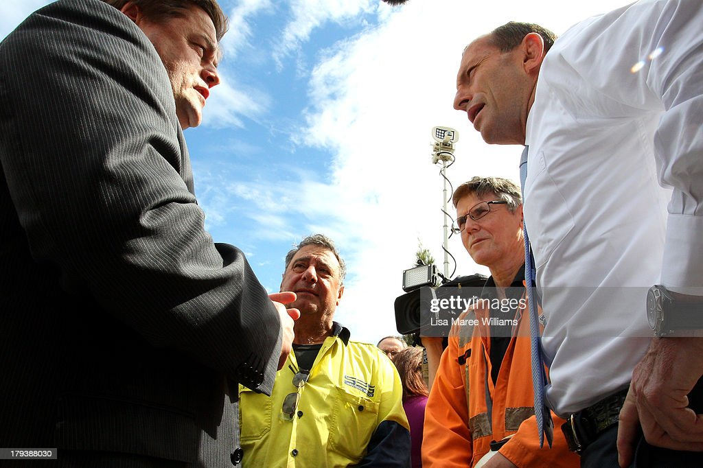 Australian Opposition Leader, <a gi-track='captionPersonalityLinkClicked' href=/galleries/search?phrase=Tony+Abbott&family=editorial&specificpeople=220956 ng-click='$event.stopPropagation()'>Tony Abbott</a> and Penrice CEO, Guy Roberts speak to workers at Penrice Holdings on September 3, 2013 in Adelaide, Australia. In the 2010 election the Australian Labor Party recorded its highest two-party-preferred vote since 1969 in South Australia, but if nationwide polling proves accurate the Liberal-National Party coalition believe they can gain seats in the state.